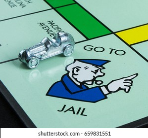 CALDWELL, IDAHO/USA - APRIL 25, 2017: A favorite childhood game by Hasbro Monopoly showing where the car landed on the go to jail spot.