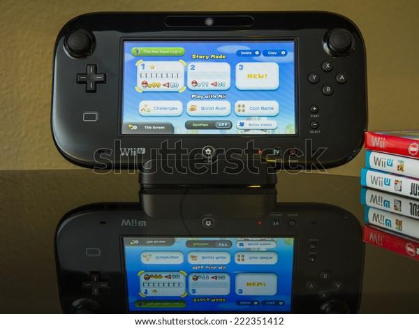 CALDWELL, IDAHO/USA - FEBRUARY 15, 2014: Wii U Game console standing up with Super Mario Bros U playing.