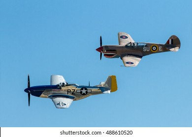 CALDWELL, IDAHO/USA - JULY 25, 2011:Two WWII planes flying in the air during the Caldwell Airshow