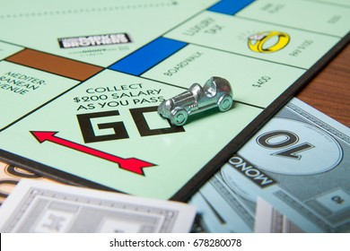 CALDWELL, IDAHO/USA - MARCH 16, 2015: Car pulling around Go to collect 200 bucks in Monopoly