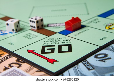 CALDWELL, IDAHO/USA - MARCH 16, 2015: Collect 200 for passing go section shown on the boardgame monopoly