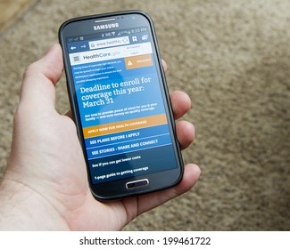 CALDWELL, IDAHO/USA - MARCH 31, 2014: Hand holding a smartphone on the healthcare website