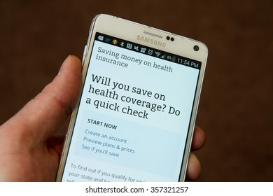 CALDWELL, IDAHO/USA - NOVEMBER 18,2015: Trying to find out if he will save on healthcare while using his smartphone on healthcare.gov in Caldwell, Idaho