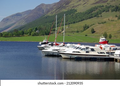 CALEDONIAN CANAL, SCOTLAND - June 09, 2013: Boats on the dock on the lake