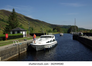 CALEDONIAN CANAL, SCOTLAND - June, 2013: Boats on the dock on the lake