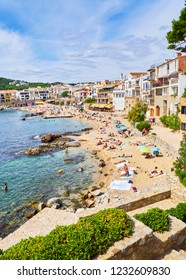 Calella de Palafrugell, Spain - September 15, 2018. Tourists enjoying a sunbathing in Platja del Canadell, the large beach of Calella de Palafrugell, Girona, Costa Brava, Catalonia, Spain.