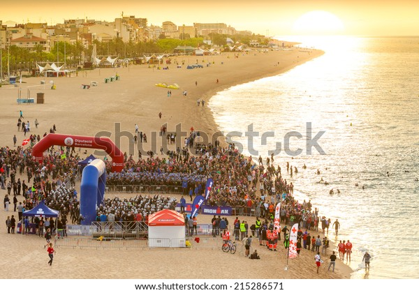 CALELLA MAY 18: Triathletes on start of the Ironman triathlon competition at Calella beach, May 18, 2014 in Calella, Spain