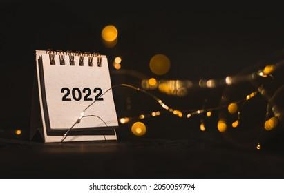 Calendar 2022 on black background with golden boken