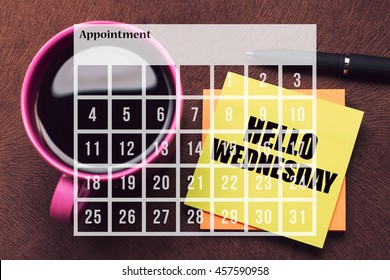 Calendar Agenda Appointment Schedule Concept. A cup of coffee with note Hello Wednesday.