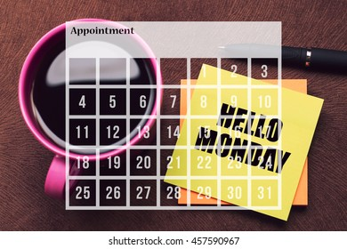 Calendar Agenda Appointment Schedule Concept. A cup of coffee with note Hello Monday.