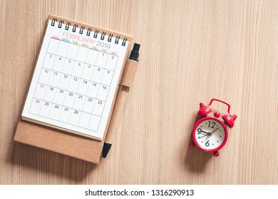 Calendar Annual With a Pen and Pocket Watch of Appointment on a Table Wooden Background. Schedule Appointment for Travel Planning Concept.