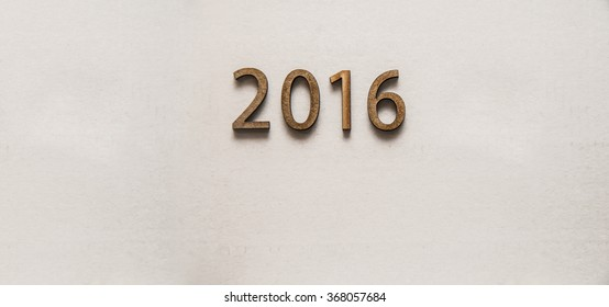 Calendar background of 2016 on paper texture. Wooden numbers. Empty copy space for inscription.