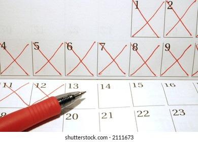 Calendar with dates crossed out in red pen
