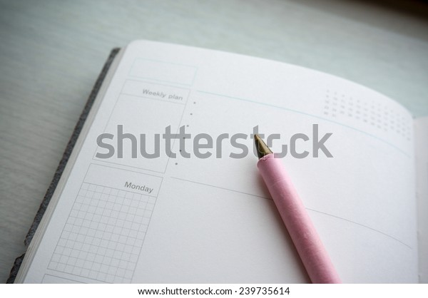 Calendar / day planner diary with pen on open page