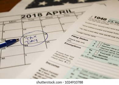 Calendar and form 1040 income tax form for 2017 showing tax day for filing is April 17 2018