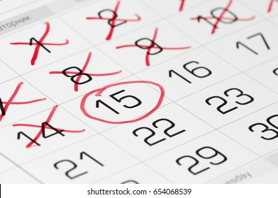 Calendar fragment shaped sheet with crossed-out numbers