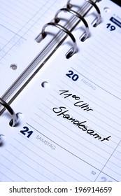 """calendar with the German entry """"11 Uhr Standesamt"""", translation: 11 o'clock register office"""