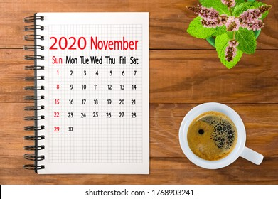 calendar image for November 2020.Coffee and flowers on the boards