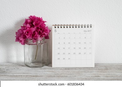 calendar may 2017 on wooden table in room
