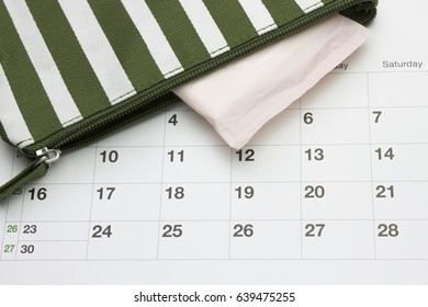 Calendar and menstruation sanitary soft cotton pads. Woman critical days, gynecological menstrual cycle. Stripe beautician with cotton pad. Travel cosmetic bag. Hygiene protection for women