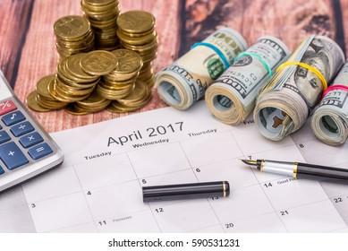 calendar, money, calculator and pen. tax concept. april.