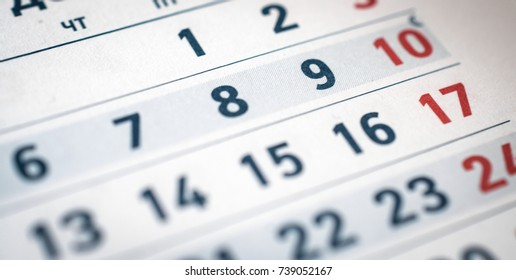 calendar numbers six, seven, eight, nine red ten close up translate: month of December