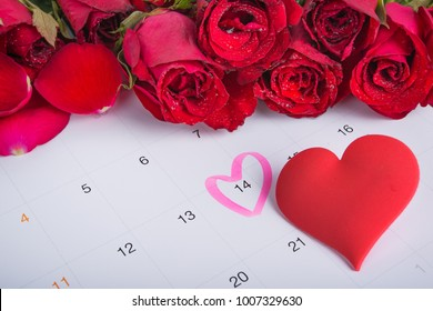 Calendar on February 14 of Saint Valentines day.Valentine's card with Red roses and red heart on the calendar date of February 14, Valentine's day.