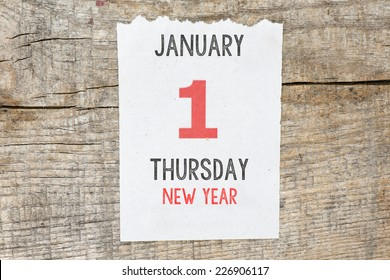 Calendar on old wooden wall. 1 January.