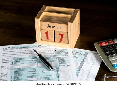 Calendar on top of form 1040 income tax form for 2017 showing tax day for filing is April 17 2018