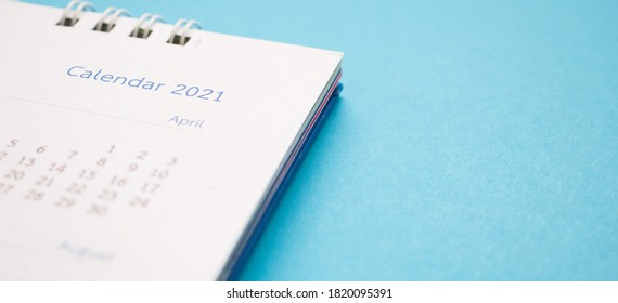 calendar page 2021 close up on blue background business planning appointment meeting concept