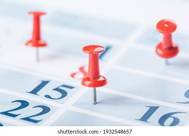 Calendar page for 2021 marked with an important date with a lot of pin. chronology, time, concept, idea, management, background