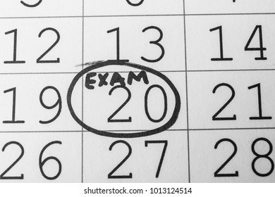Calendar page with date reminder about exam, closeup