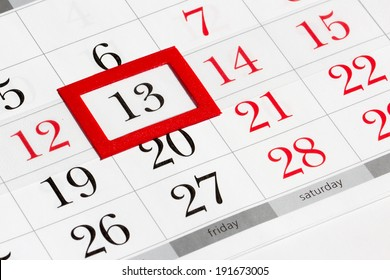 Calendar page with marked date of friday 13th