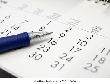 A calendar with a pen