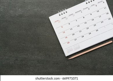 calendar and pencil on the table, planning concept