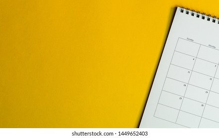 Calendar or planner on yellow background with copy space. Business schedule concept.