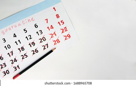 Calendar with red pencil days spent in quarantine due to coronovirus.