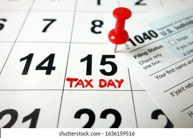 Calendar showing date April 15 2020 with 1040 form, tax day in USA concept