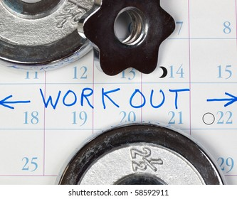 Calendar showing workout schedule and chrome weight plates