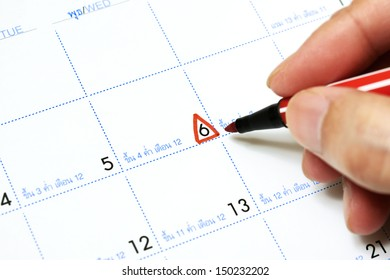 Calendar with triangle marking at 6