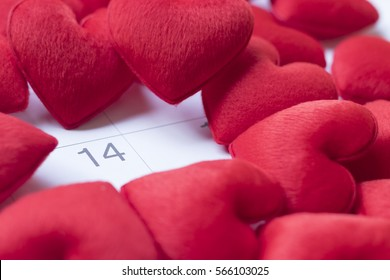 Calendar Valentines day and red hearts. Focus at  February 14 as a reminder. Celebration concept. Top view.