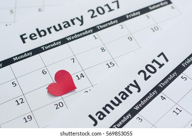 Calendar Valentines day and red hearts paper