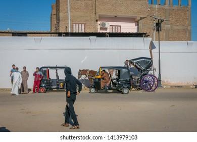 Calesa and tuc tuc, mototaxi at the entrance to the temple of Edfu.Egypt April 2019