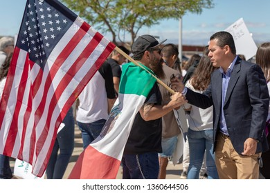 CALEXICO, CA - APRIL 5, 2019: Protesters march in Calexico as President Trump arrives to see work on the border fence.