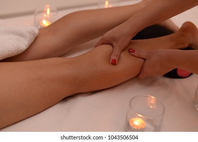 Calf muscle massage with fingers pressure