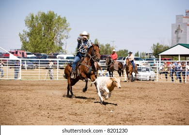 A calf roping image for a local rodeo