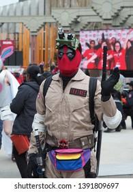 Calgary, AB / Canada - April 26 2019: Cosplay enthusiast portraying Deadpool walks through the Calgary Comic Expo Parade