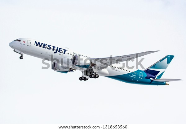 Calgary, AB - Feb 20, 2019 WestJet's first revenue flight of the Boeing 787 Dreamliner at Calgary International Airport bearing the name of company found, Clive Beddoe