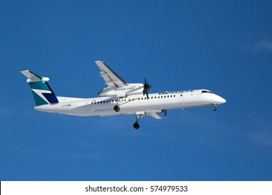 Calgary AB - January 18, 2017. A WestJet Encore Bombardier Q400 on approach to Calgary International Airport