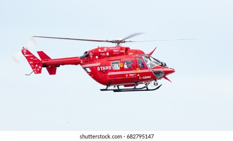 CALGARY, AB - JULY 9, 2017 STARS Air Ambulance flying in their BK-117 at Calgary International Airport